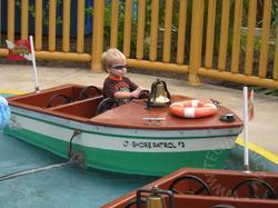 JSL drives a boat.