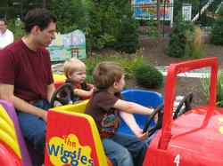 Boys driving the Big Red Car.